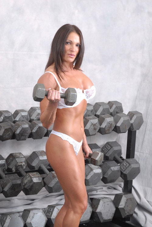 Sexy bodybuilder Kristine poses in white lingerie