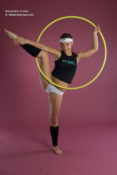 Flexible gymnast girl Alexandra exercises with a hoop