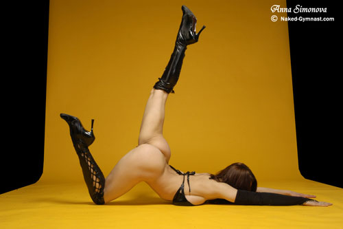 Flexible gymnast babe stretching with raised leg