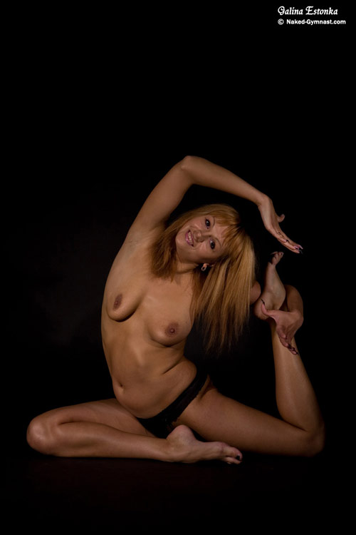 Side nude stretch by a contortion gymnast