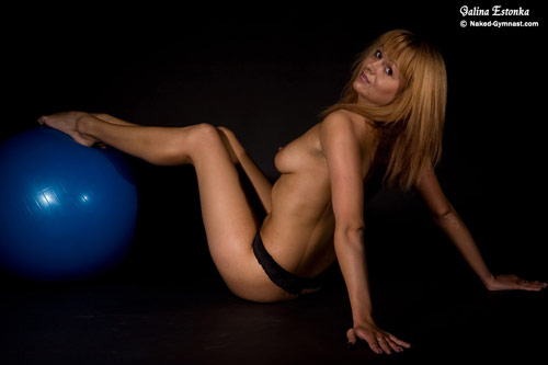 Nude fitness ball gymnastics in studio