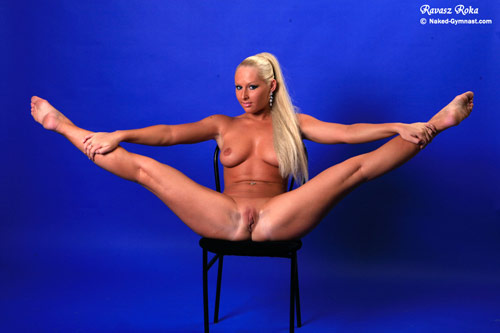 Nude contortion girl in a seated wide-legged pose