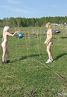 couple of ladies play with ball