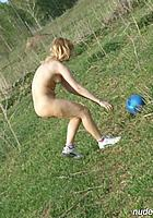 girl picks up ball