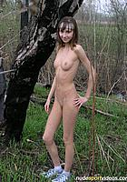 nude girl posing in forest