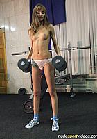 nude brunette with dumbbells