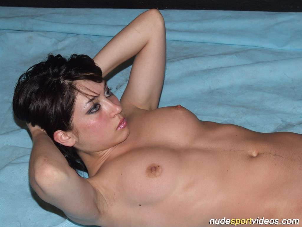 Sexy brunette does exercises nude in her living rom