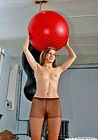 girl holding fitness ball in hands