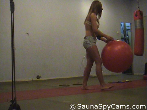 Voyeur camera films a fitness babe with a ball