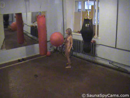 Naked exercises with a Swiss ball in gym voyeur mode