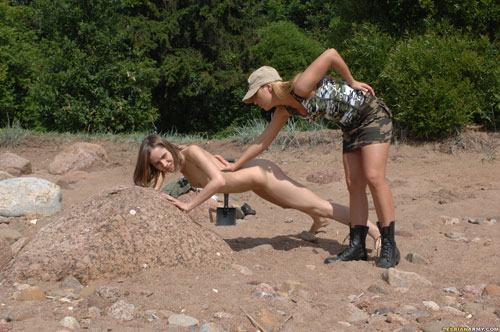 Very special military training of a nude female soldier