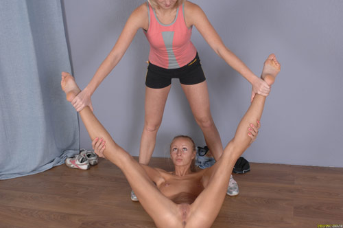 Spine nude stretch with lesbian sport help