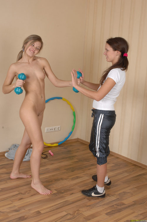 Playful nude lesbian dumbbell training
