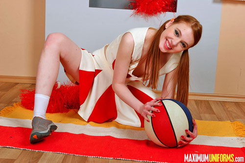 Naughty cheerleader Leeloo plays with a ball