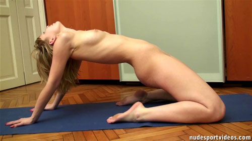 A knelt backbend by a naked flexible girl
