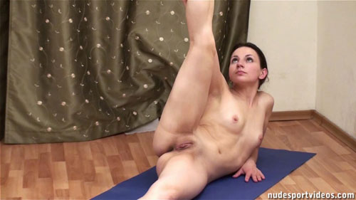 Spread nude gymnastic pussy and raised leg