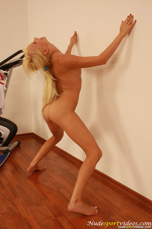 Slim nude sport girl does a gymnastic bend