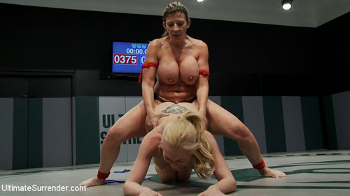 Tiny blond vs Huge titted Amazon. Can the the monster boobed rookie beat the smaller veteran? Non-scripted brutal wresting, winner fucks the loser!