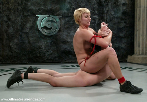 Two girls in catfight action on the mat